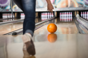 Rolling a bowling ball down a lane